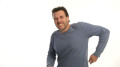 Mature man getting a back ache on white background Stock Footage