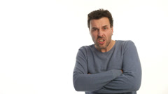 Mature man getting angry on white background Stock Footage
