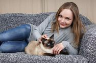 Happy young woman with cat Stock Photos