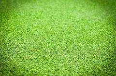 Artificial grass background with vignetting added. Stock Photos