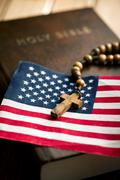 Holy bible with american flag and crucifix Stock Photos