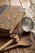 kitchen tools with cookbook - stock photo