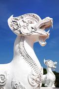 White singha statue , the legendary animal literature. Stock Photos