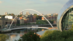 the sage and millennium bridge, newcastle upon tyne river skyline, england - stock footage