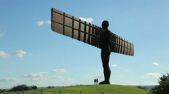 two men visit angel of the north, gateshead, tyne and wear, england - stock footage