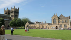 Visitors to durham cathedral and palace green, england Stock Footage