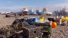 Lobster pots and fishing boats at Beer in Devon Stock Footage