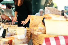 Stand with cheese at city market NTSC Stock Footage