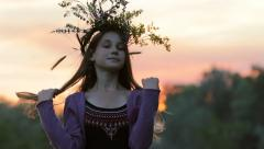 Silhouette Young Girl Wearing Flower Wreath  in Park at Sunset HD Stock Footage