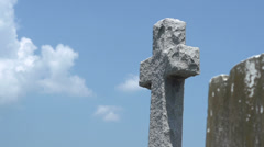 Stone cross in graveyard slider shot Stock Footage