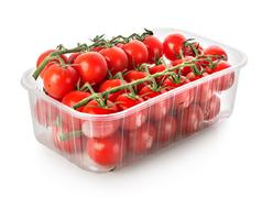 Cherry tomatoes in a container Stock Photos