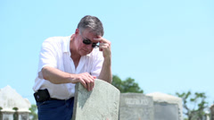Upset mature man visiting grave Stock Footage