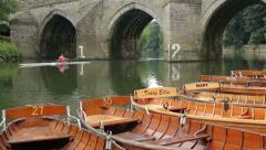 Man rows under elvet bridge, river wear, durham, england Stock Footage