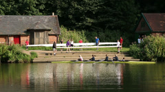 People launching rowing boats onto river, durham, england Stock Footage