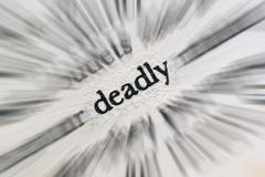 word deadly in the book - stock photo