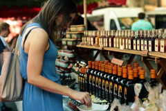 Young woman tasting food sample on city market NTSC Stock Footage
