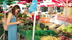 Beautiful woman on vegetable, food city market - EDITORIAL Stock Footage