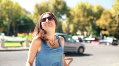 Portrait of happy beautiful woman by the city street HD Stock Footage