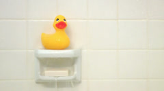 Yellow Rubber Duck Ducky on Soap Holder in Shower Bathtub - stock footage