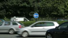 traffic on main road roundabout, durham city centre, england - stock footage