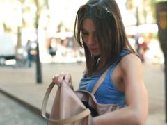 Woman in city searching cellphone in her bag NTSC - stock footage