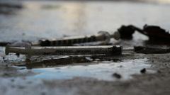 Drug addict's discarded needle (4) Stock Footage