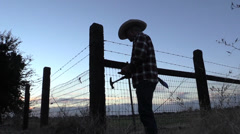 Cowboy silhouette hamering Stock Footage