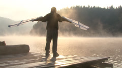 Funny young people in the foggy sunrise morning playing in the lake Stock Footage