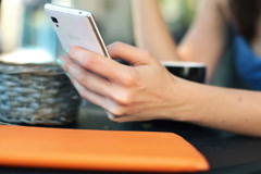 Closeup of woman hands texting, sending sms on smartphone in cafe NTSC - stock footage