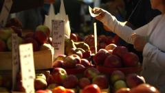Buying apples at Farmer's Market Produce Stand Stock Footage