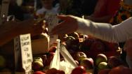 Stock Video Footage of Transaction at Farmer's Market - Buying apples