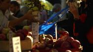 Stock Video Footage of Women buy apples and flowers at Farmer's Market