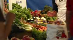 Foreground Transaction at Farmer's Market Vegetable Stand Stock Footage