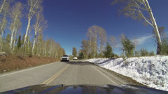 Mountain snow road in autumn cars travel POV HD 0108 Stock Footage