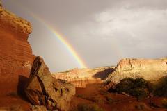 Rainbow and brief dramatic sunshine Stock Photos