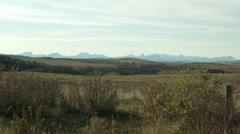 Long prairie distant mountain shot Stock Footage