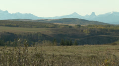 long prairie shot mountains in background - stock footage