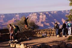 Tourists gaze over the south rim Stock Photos