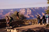 Stock Photo of tourists gaze over the south rim