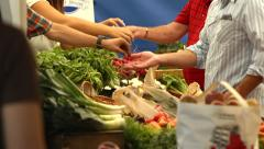 Multiple transactions at Farmer's Market Vegetable Stand Stock Footage