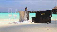 Champagne on ice for two, on a tropical white beach Stock Footage