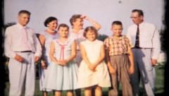 558 - the family gathering turns into photo session - vintage film home movie Stock Footage