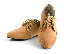 Casual brown leather unisex shoes Stock Photos