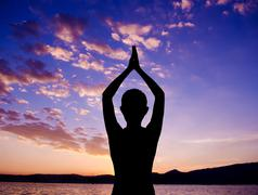 Silhouette yoga prayer pose Stock Photos