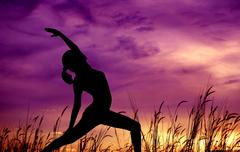 Silhouette woman yoga at outdoor park. Stock Photos