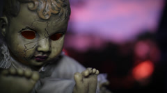 Omen Doll at Dusk | October Sky Stock Footage