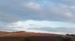 Sunset timelapse and moving clouds over the farm fields - stock footage