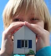 Boy holding house Stock Photos