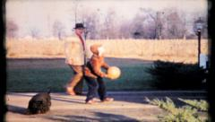 Father and son play driveway basketball, 553 vintage film home movie Stock Footage