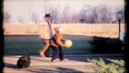 Stock Video Footage of 553 - father & son play driveway basketball - vintage film home movie